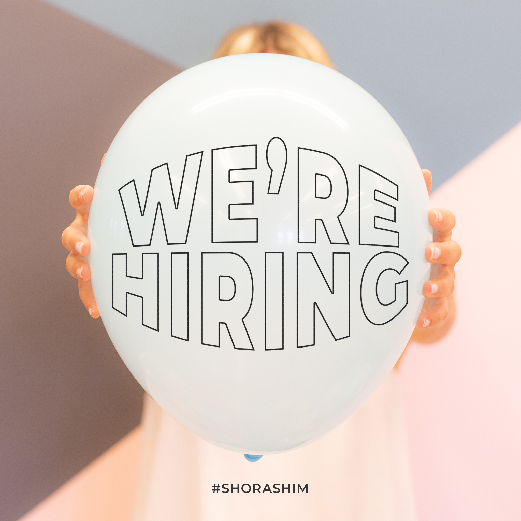 """Girl holding Balloon with """"We Are Hiring"""" Text on it"""